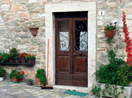 Door with flowers Le Marche hilltop town holiday off the beaten track