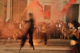 Fire juggling stilts festivals fairs Urbino Marche Italy